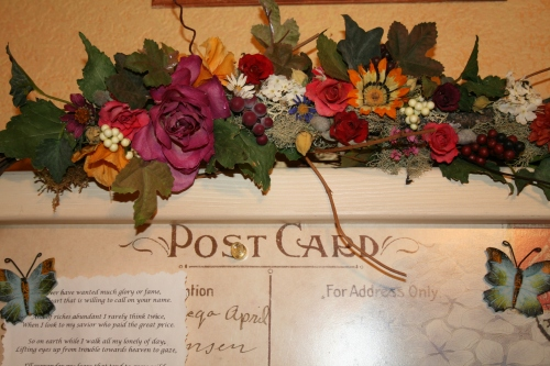 Floral accents adorn the message board in my artist's loft
