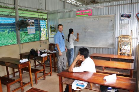 Jesse, Elya's boyfriend,  tutoring at the Cambodian school