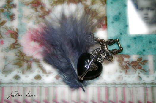 grey feather  with jewelry heart