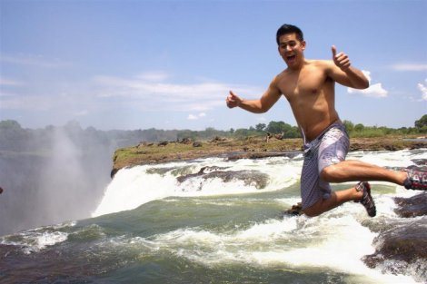 Josiah jumping into Victoria Falls, South Africa