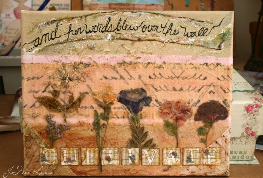 Word Gardening...and her words blew over the wall...mixed media