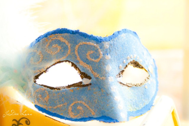 blue masquerade mask with glitter glue