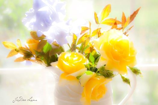 purple iris with yellow roses