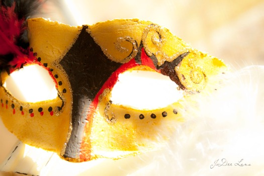 Jester masquerade mask with yellow, black, and red