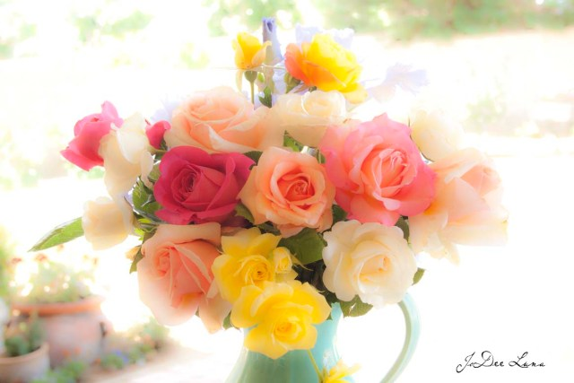 Mulit-colored Roses in a Green  Vase