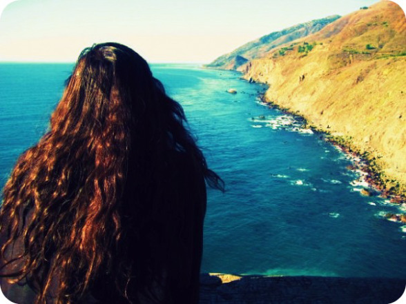 Elya gazing at ocean
